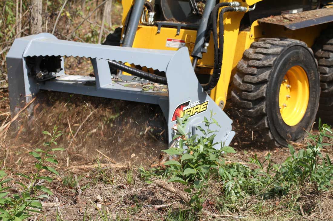 Baumalight Skidsteer mulcher clearing a brush