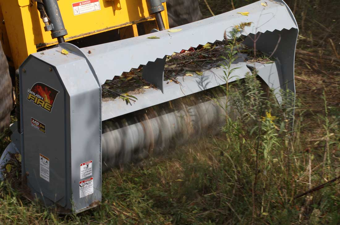 Rotating blades of the Baumalight skidsteer Brushfire