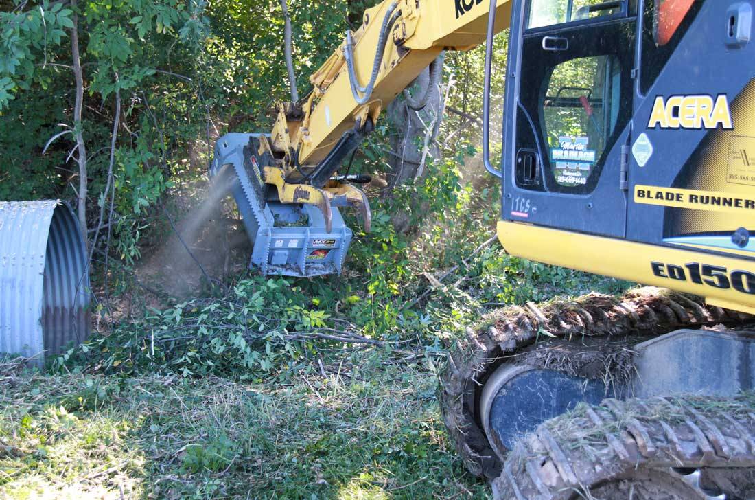 Ditch clearing with brush mulcher on excavator