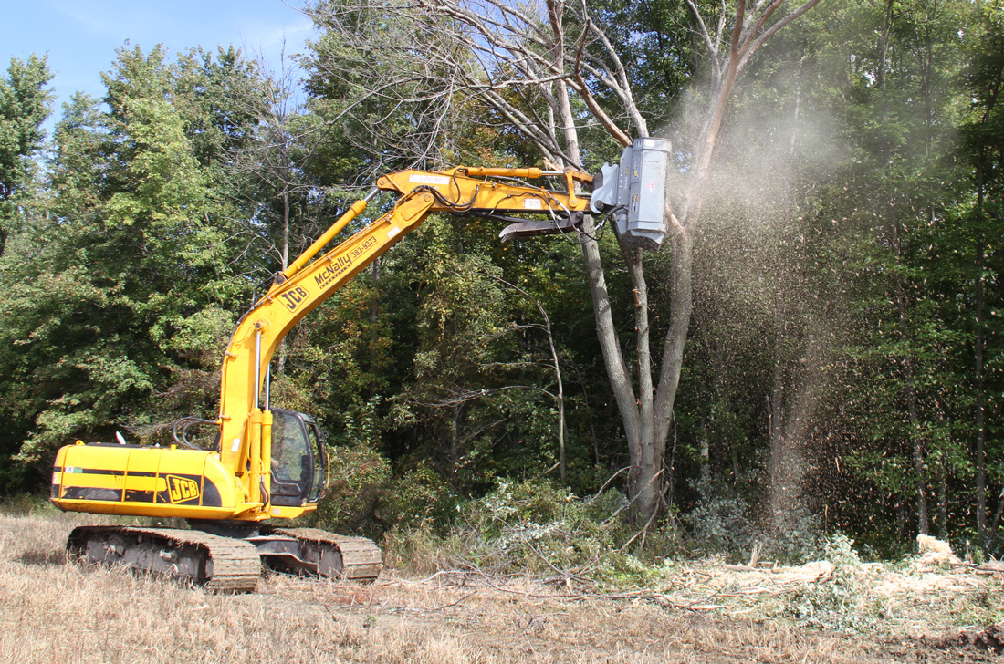 Trimming down with excavator mounted brush mulcher