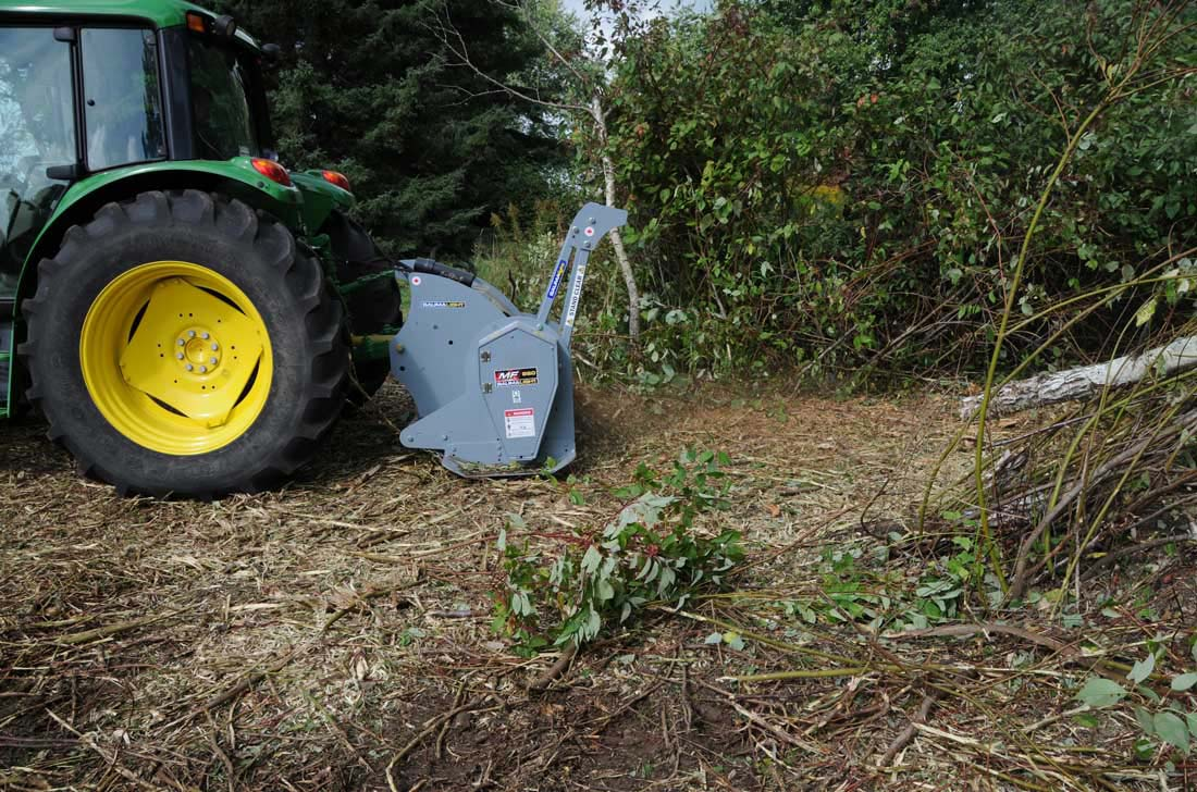 Land clearing with mulcher on tractor