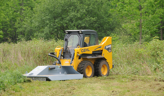 Skidsteer mounted Baumalight BrushCutt CF372 getting ready for clearing