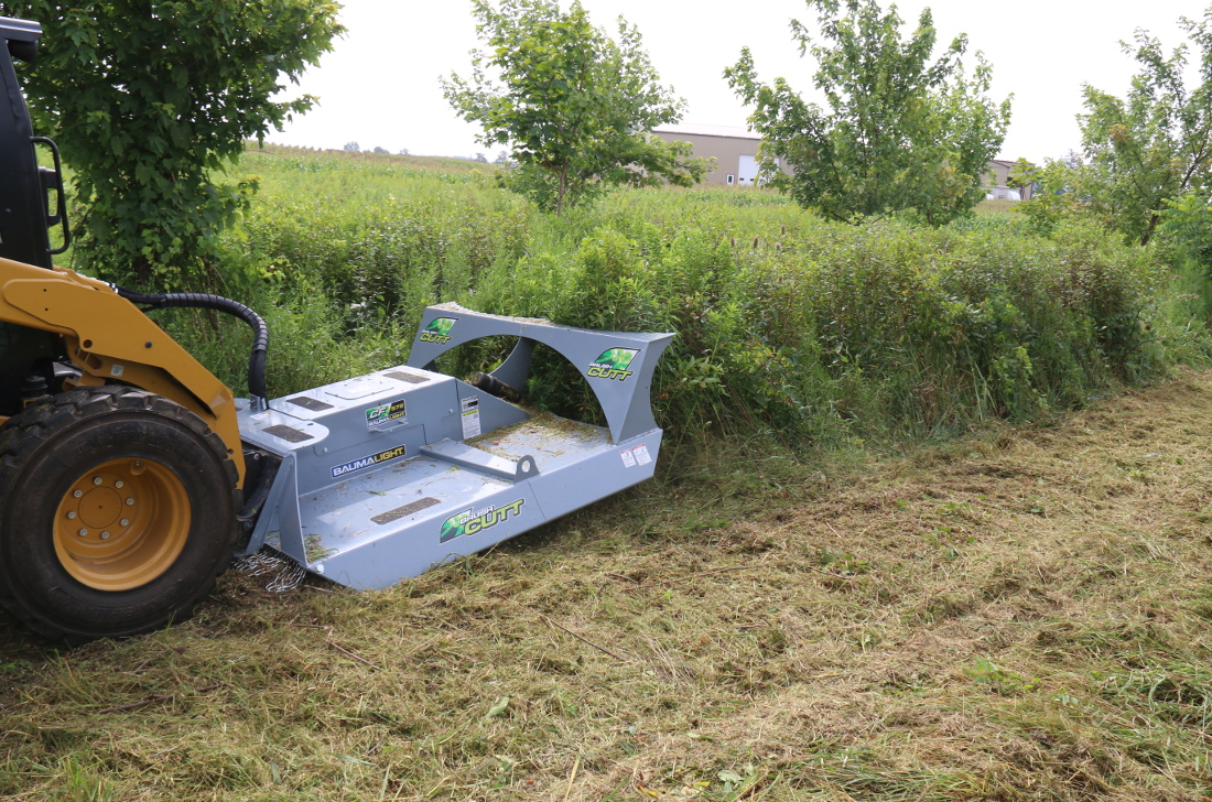 CF572 rotary cutter mowing heavy grass