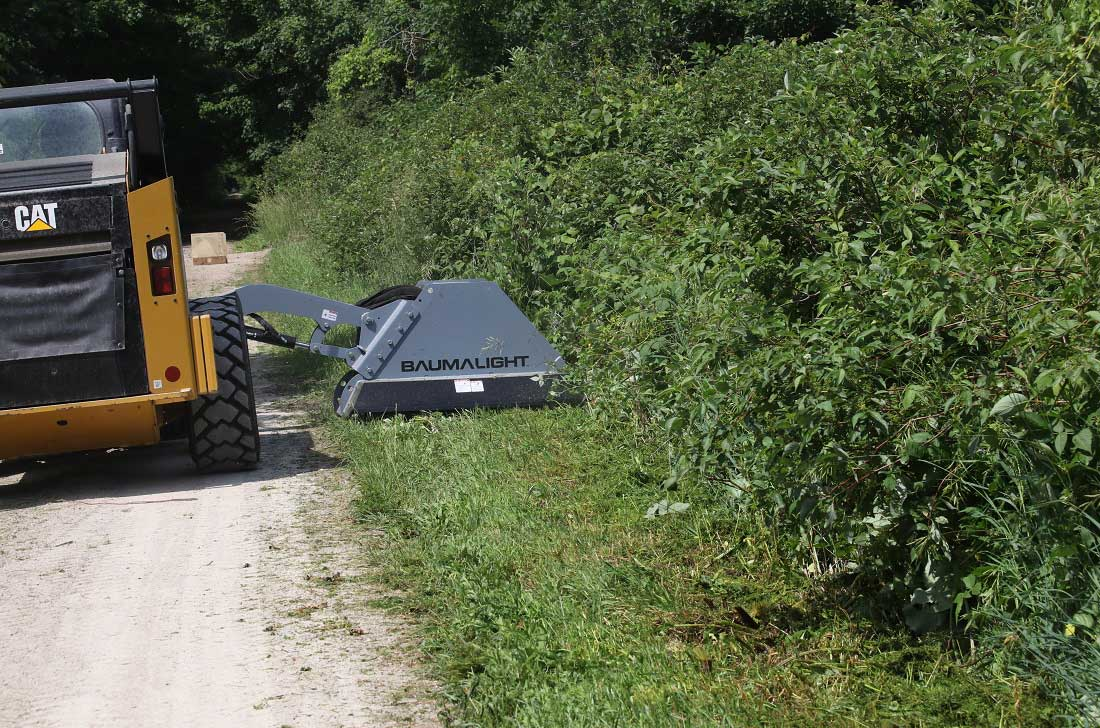 Trail maintenance with cat skidsteer