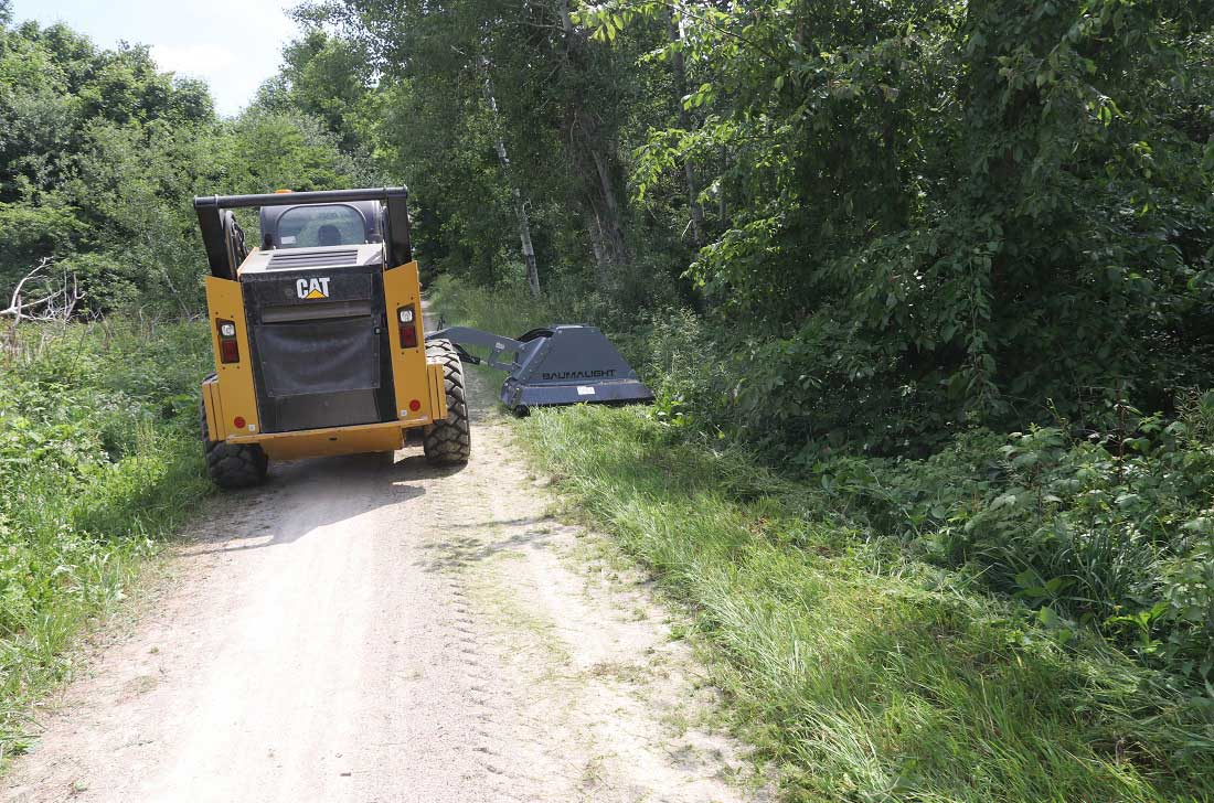 Trail maintenance with skidsteer