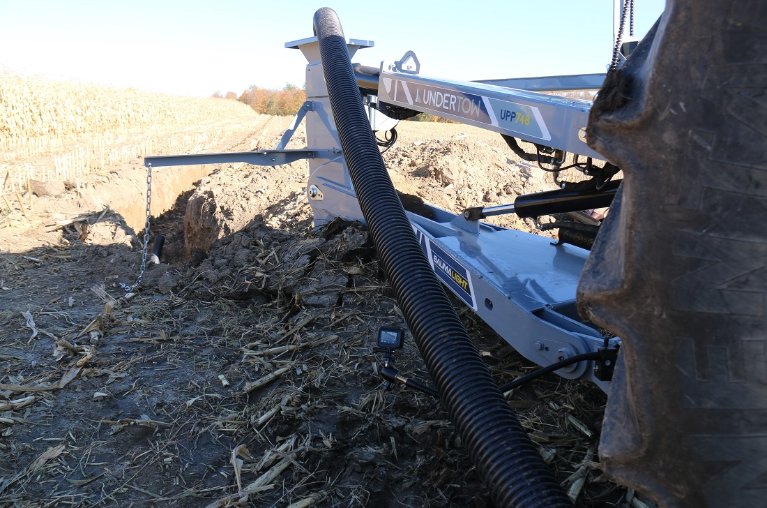 Undertow tile plow for tractor